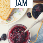 Overhead shot of a jar of blackberry jam with text title overlay
