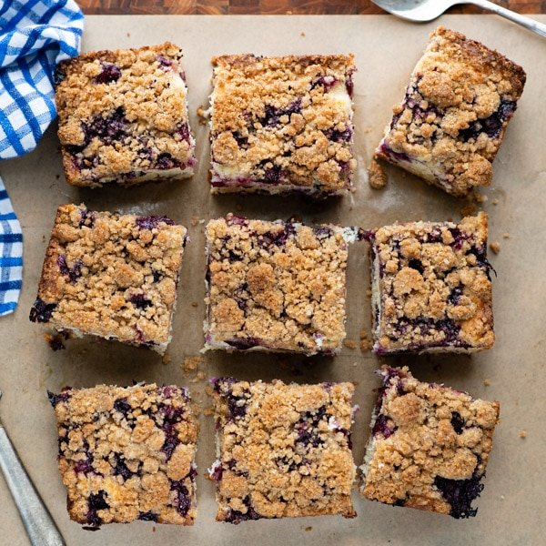 Square overhead image of classic blueberry buckle cut into squares