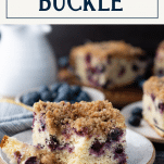 Bite taken out of a classic blueberry buckle with text title box at top