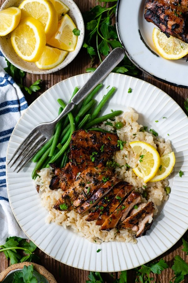 Overhead shot of chicken thigh marinade recipe served with rice and green beans.