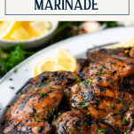 Side shot of chicken thigh marinade on a platter with text title box at top