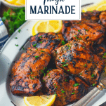 Side shot of a tray of chicken thigh marinade with text title overlay