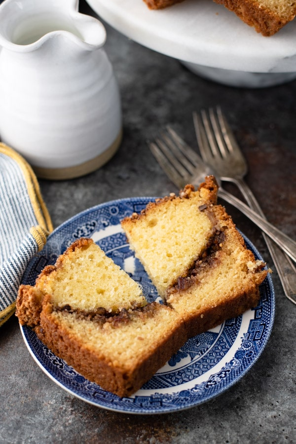 Close up overhead shot of a slice of tasty cinnamon bread on a blue and white plate