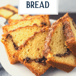 Close up shot of slices of cinnamon quick bread on a serving tray with text title overlay