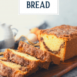 Side shot of a loaf of sliced cinnamon swirl bread with text title overlay
