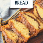 Sliced loaf of cinnamon bread with text title overlay