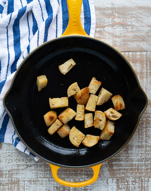 Homemade croutons in a cast iron skillet