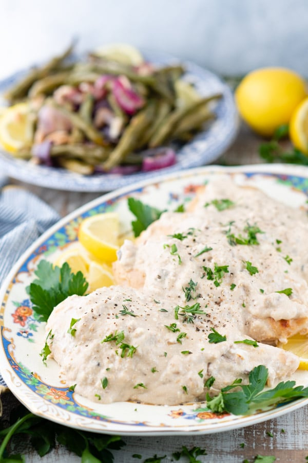 Side shot of a platter of baked chicken with cream of mushroom soup recipe