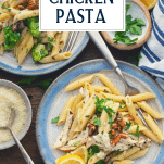 Creamy chicken pesto pasta on a plate with text title overlay