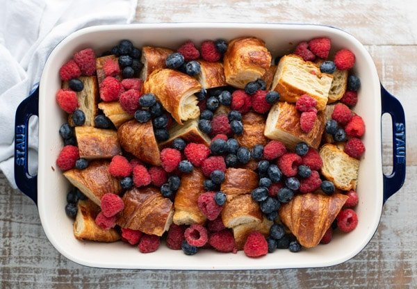 Croissants and berries in a baking dish