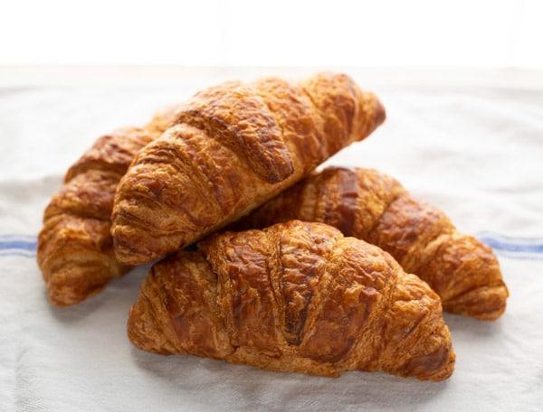 Croissants on a white table