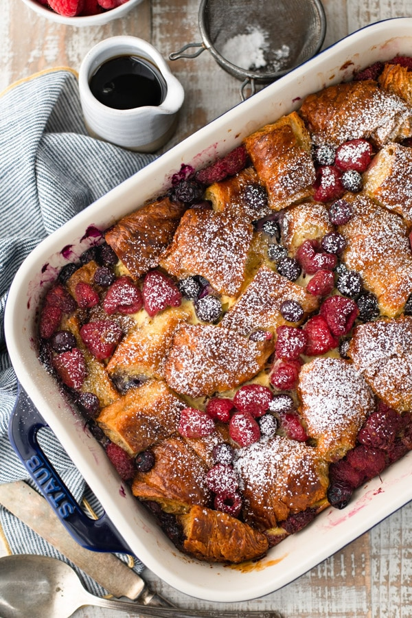 Overhead image of the best breakfast casserole with croissants and berries
