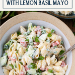 Close overhead shot of pasta salad with mayo and text title box at top