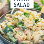 Close side shot of pasta salad with mayo and text title overlay