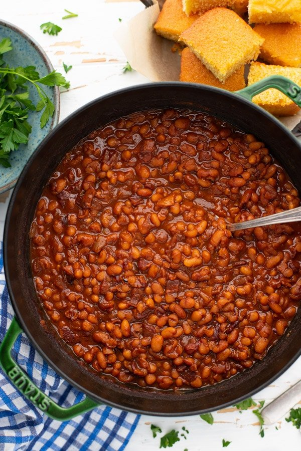 Overhead shot of a pot of homemade baked beans with bacon