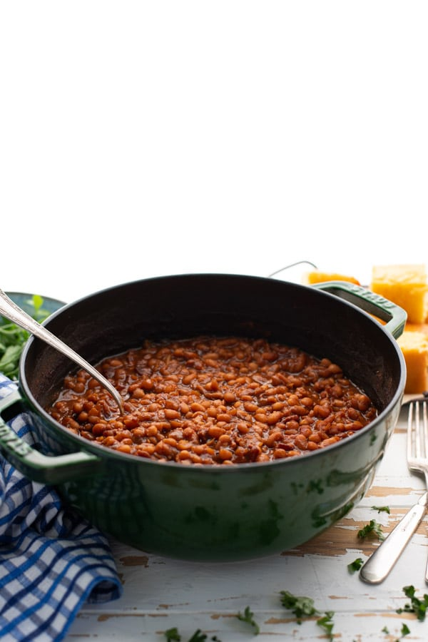 Side shot of a pot of homemade baked beans.