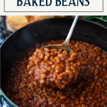 Close up shot of a ladle full of homemade baked beans from scratch with text title box at top