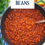 Overhead shot of Boston baked beans with text title overlay