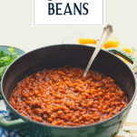 Pot of homemade baked beans with text title overlay