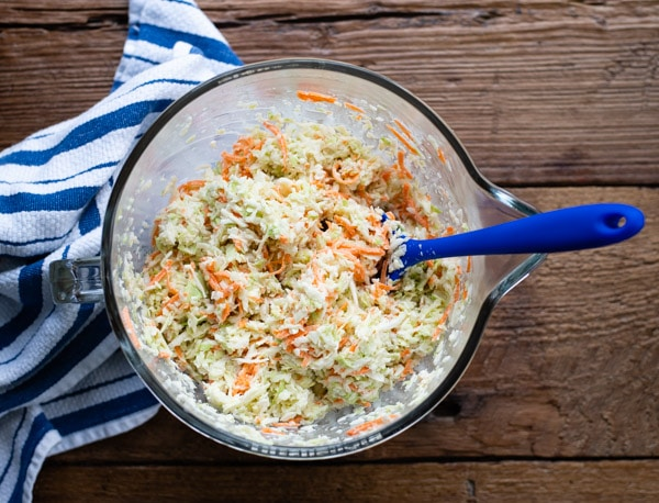 Process shot showing how to make homemade coleslaw