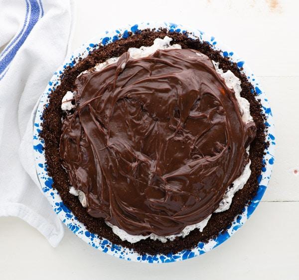 Process shot showing how to make layered ice cream pie recipe