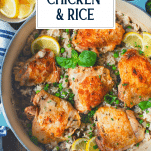 Overhead image of a pot of chicken thighs and rice