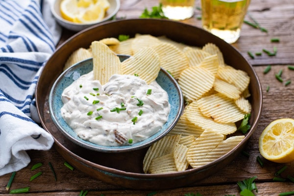 Horizontal shot of a platter of chips with caramelized onion dip