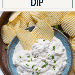Bowl of onion sour cream dip with text title box at top