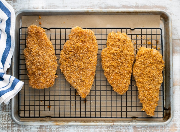 Process shot showing how to cook pecan crusted chicken