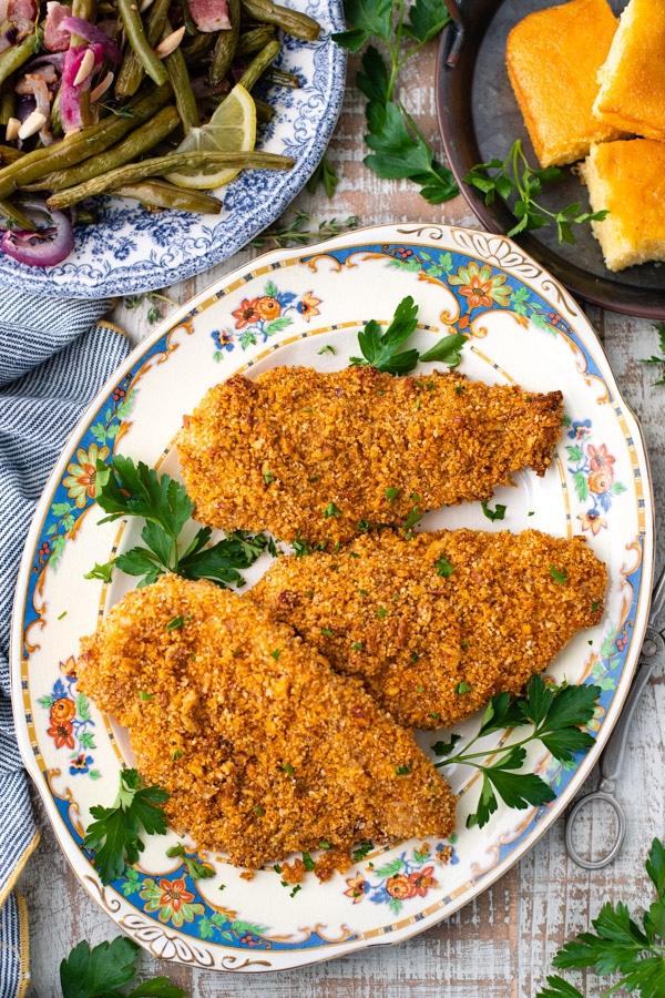 Overhead image of a platter full of honey mustard pecan crusted chicken