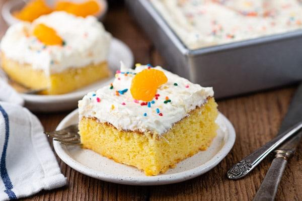 Horizontal shot of an orange pineapple pig pickin cake on a white plate