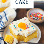 Slice of orange pineapple cake with text title overlay