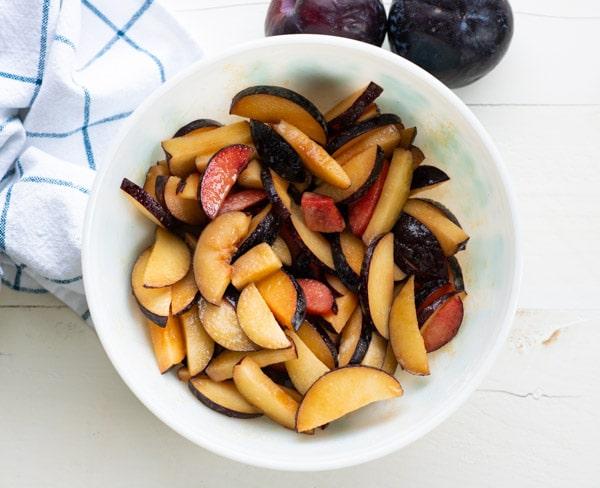 Bowl of filling for plum crisp recipe