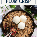 Overhead image of a cast iron skillet with plum crisp and a text title box at the top
