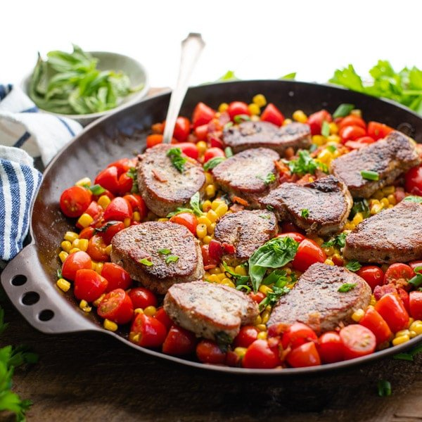 Square side shot of easy pork medallions in a pan