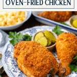 Side shot of oven fried chicken recipe on a plate with text title box at top
