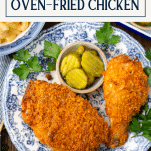 Overhead shot of a plate of oven fried chicken with text title box at top