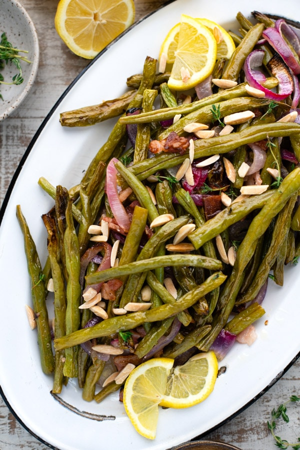 Close overhead image of a white enamel tray filled with the best roasted green beans