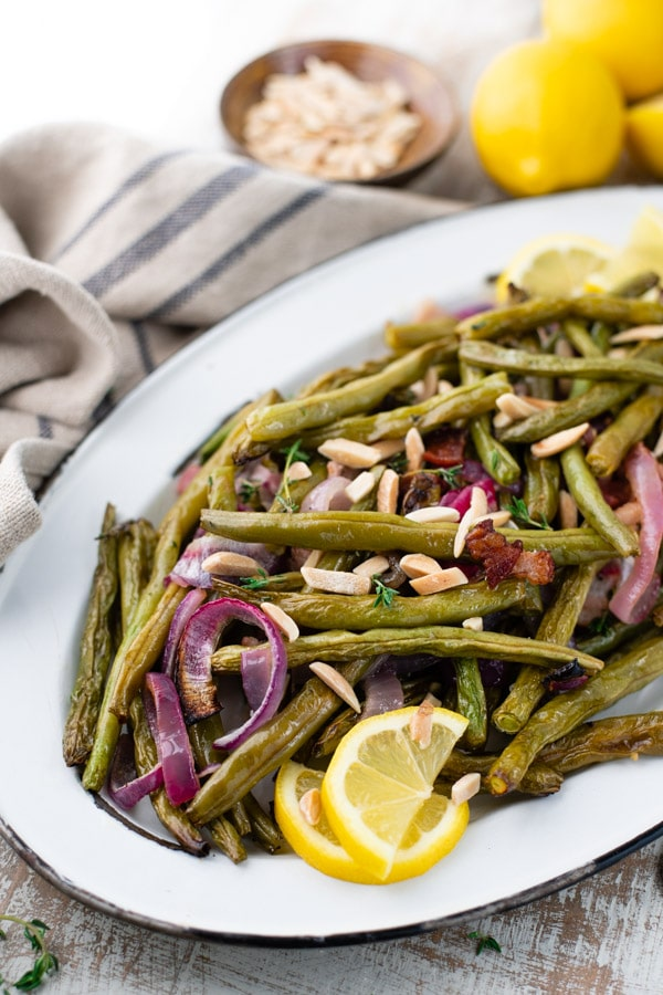 Close side shot of a platter of roasted green beans