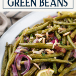 Close up side shot of a tray of roasted green beans with bacon with text title box at top