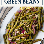 Overhead shot of a platter of roasted green beans with text title box at top
