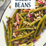 Close overhead image of a tray of crispy roasted green beans with text title overlay