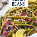 Close up shot of oven roasted green beans with bacon and text title overlay