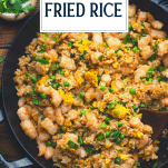 Overhead shot of homemade shrimp fried rice with text title overlay