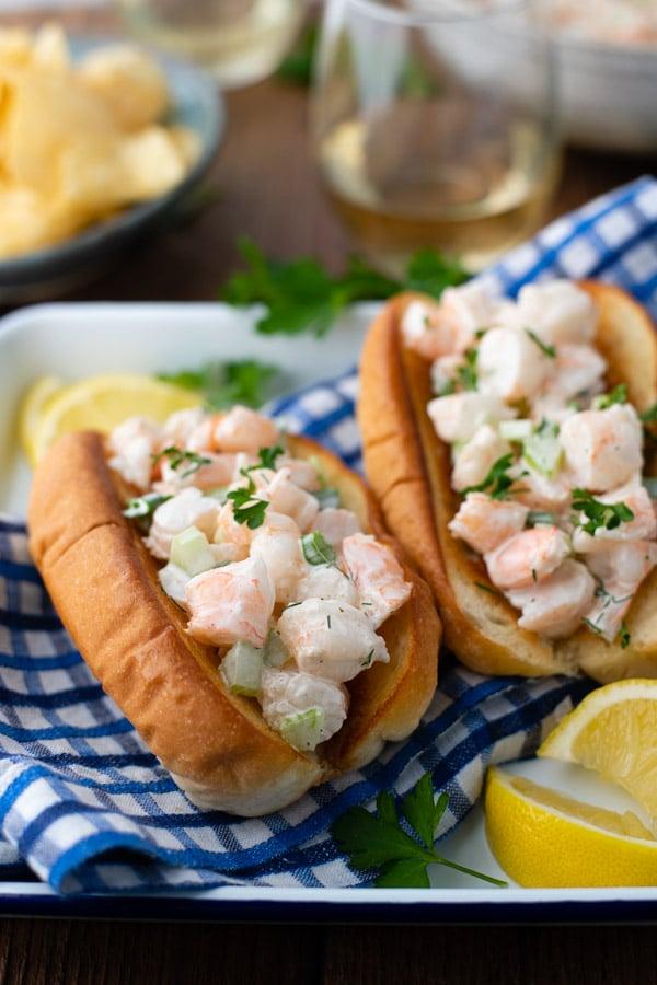 Side shot of a plate of shrimp rolls