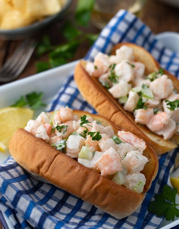Side shot of a platter of New England shrimp rolls