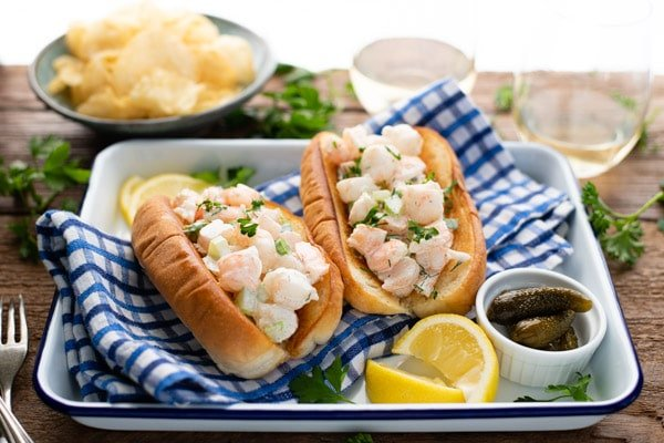 Horizontal front shot of a platter of the best New England shrimp roll recipe