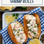 The best shrimp roll recipe served with lemon wedges with a text title box at the top