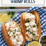 Overhead image of a platter of New England shrimp rolls with a text title box at the top