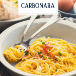 Side shot of a bowl of easy spaghetti carbonara with text title overlay